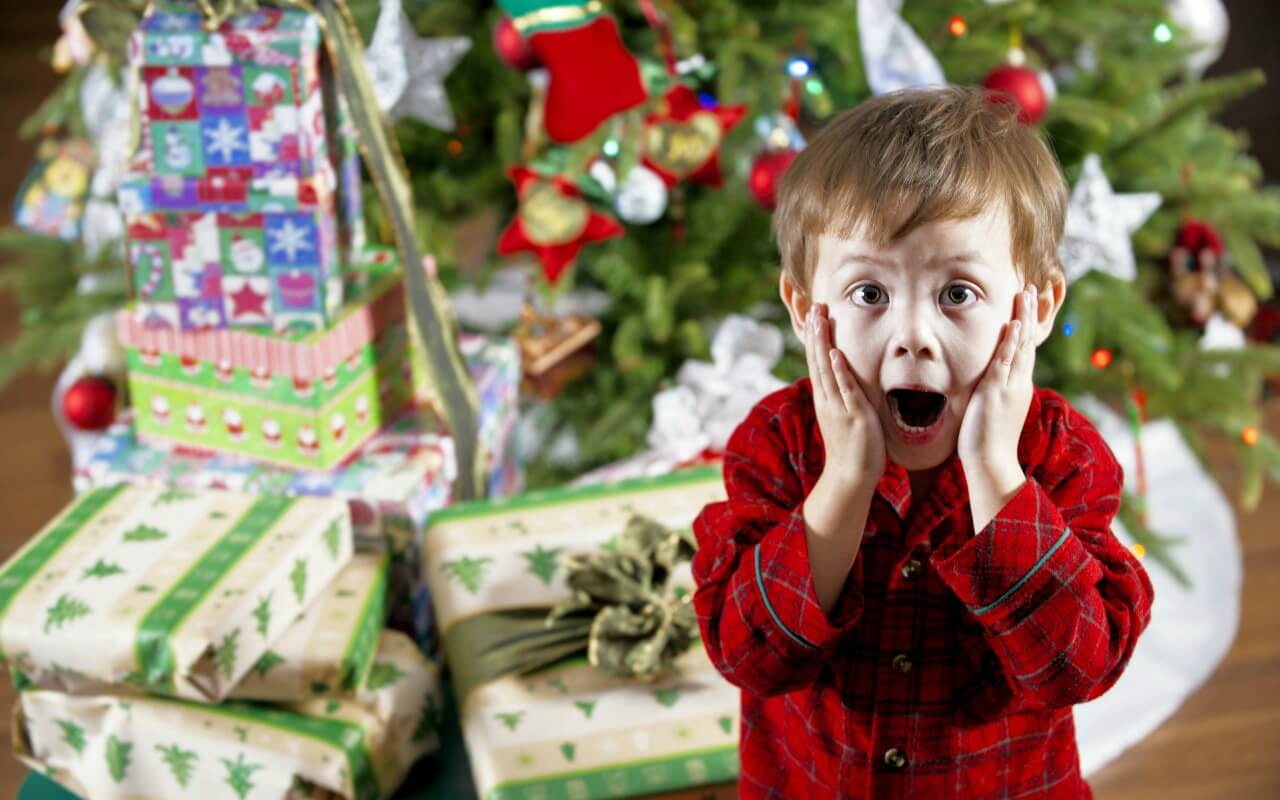Surprised little boy on Christmas morning