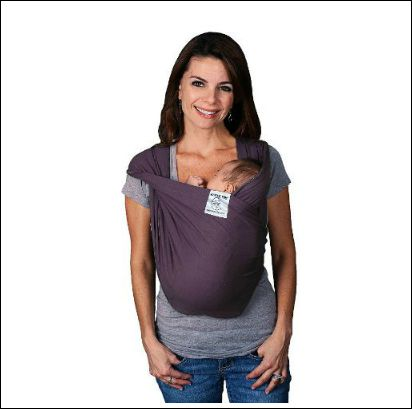 New mom wearing infant in a Baby K'Tan baby carrier
