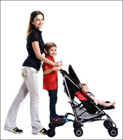 Mom with baby stroller and older son riding on kickboard