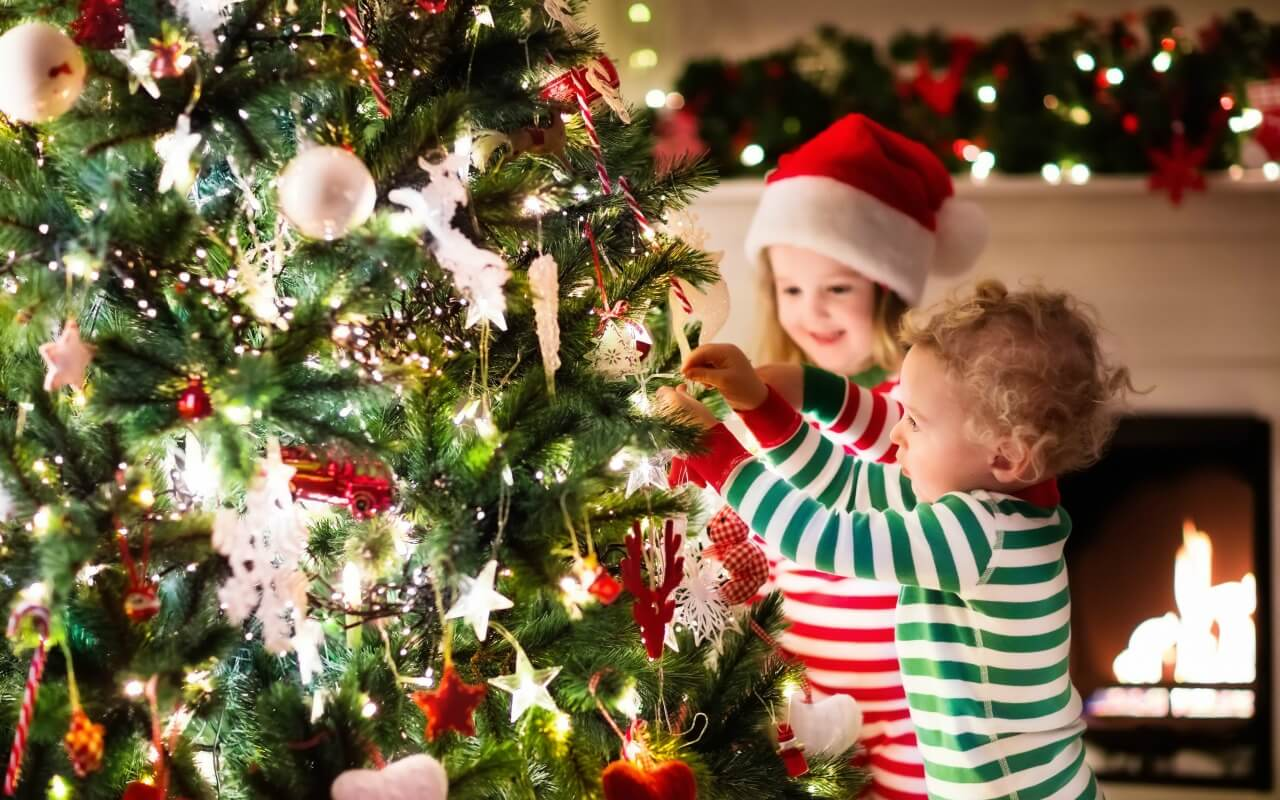 Cute kids decorating a Christmas tree
