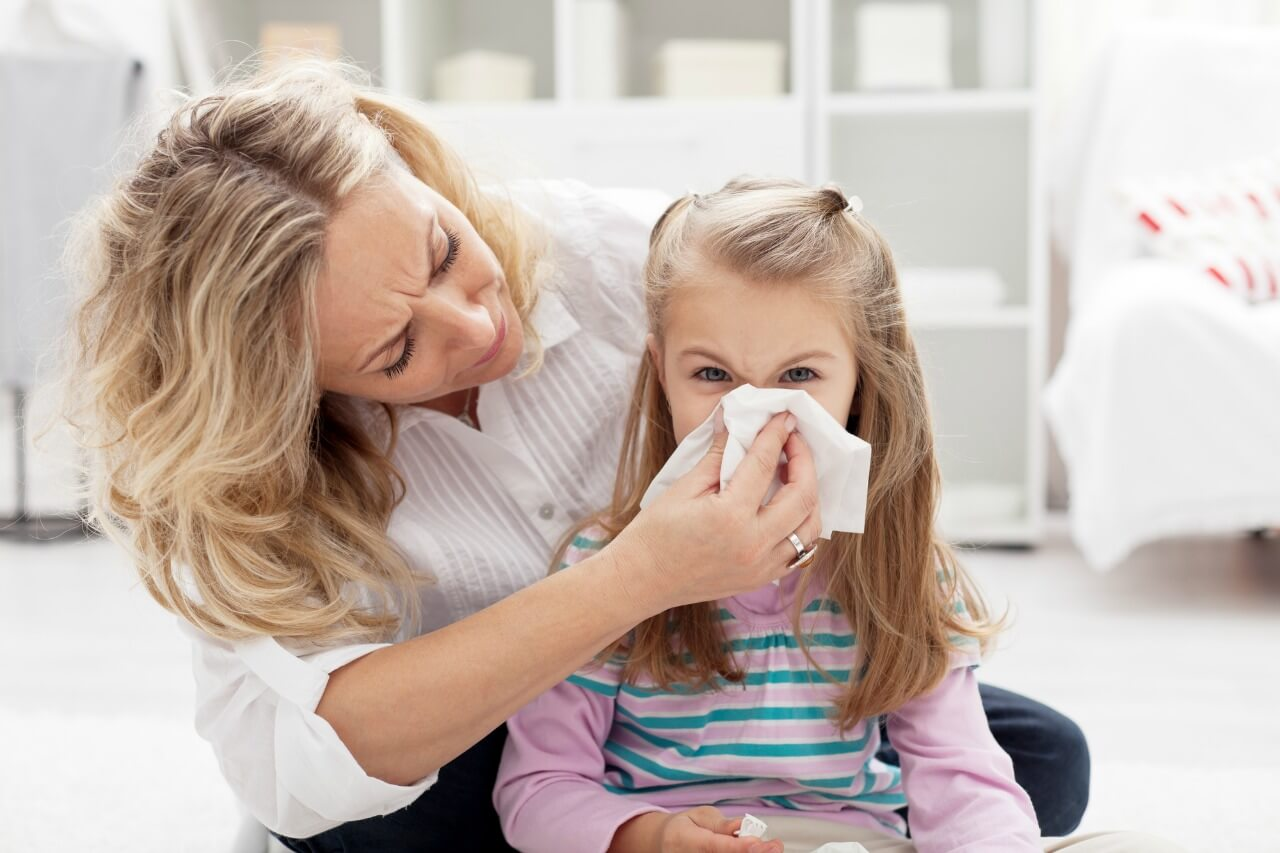 Mom with sick little girl during cold and flu season