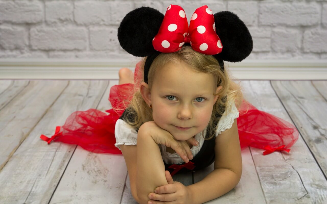 Little girl wearing Minnie Mouse ears